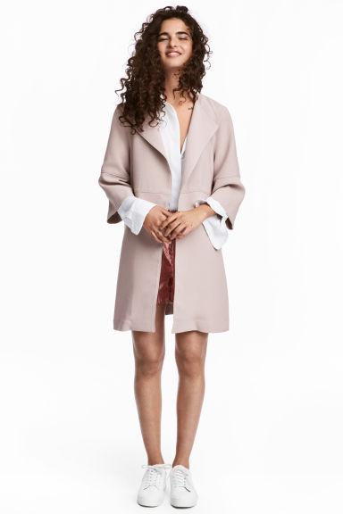 Abrigo de mujer rosa